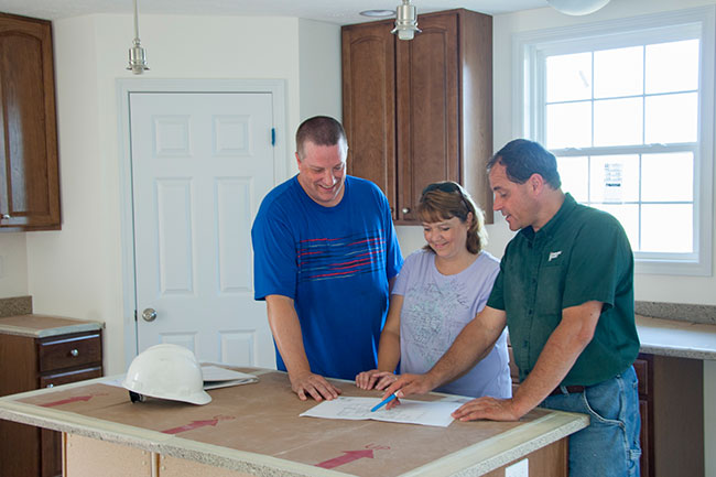 family in custom home kitchen